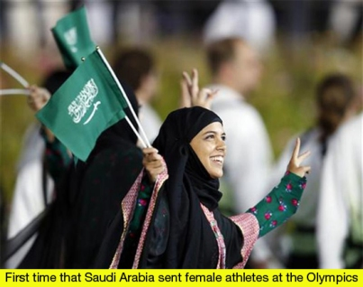 Saudi Arabia's contingent takes part in the athletes parade during the opening ceremony of the London 2012 Olympic Games at the Olympic Stadium